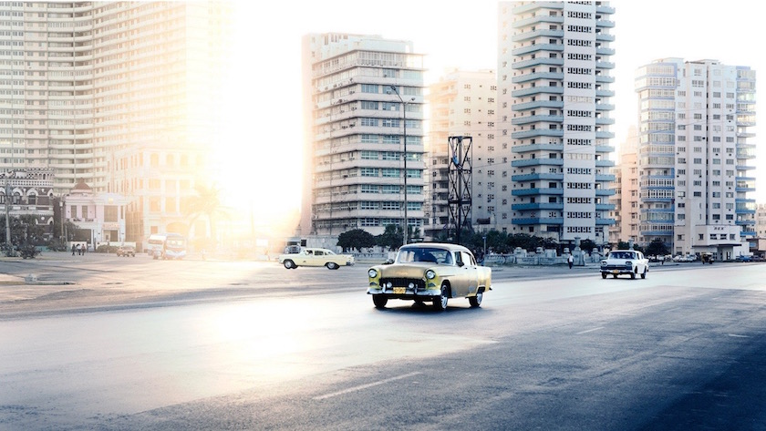cityscape city buildings sun sunny bright light car vintage cars
