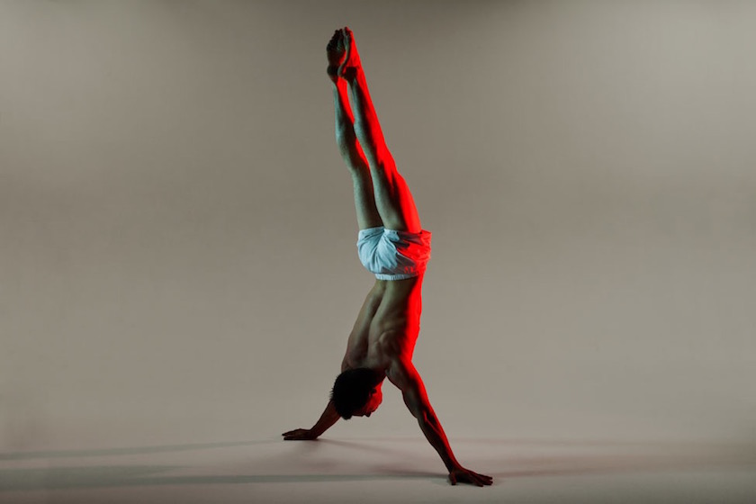 photograph photographer photo man photographers photography sport gymnastic gymnastics body arm arms handstand shorts red light
