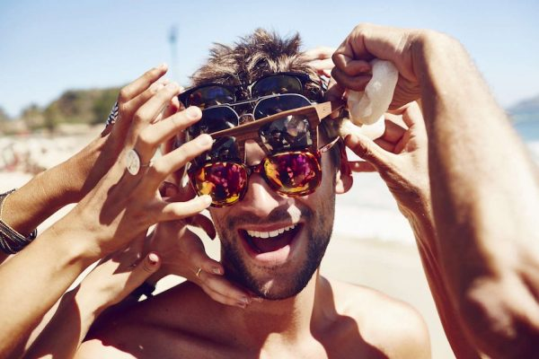 photo photos photography photographer photographers young man head face glasses sunglasses hand hands touch laugh smile laughing smiling sun sunny warm summer happy