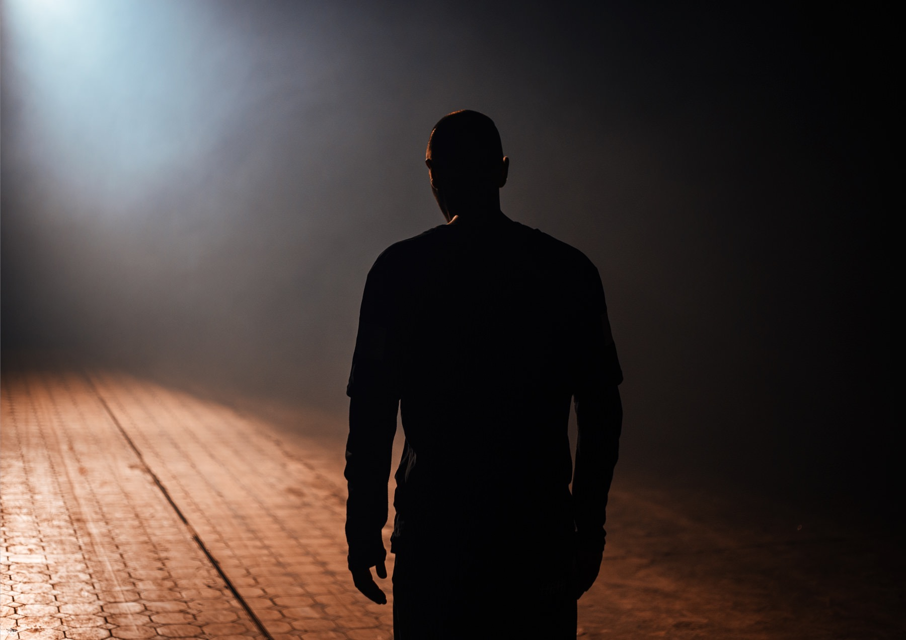 ­photo, photos, photography, photographer, photographers, man, men, backlight, backlit, silhouette, dark, standing, blur, perspective, spotlight, nighttime, night